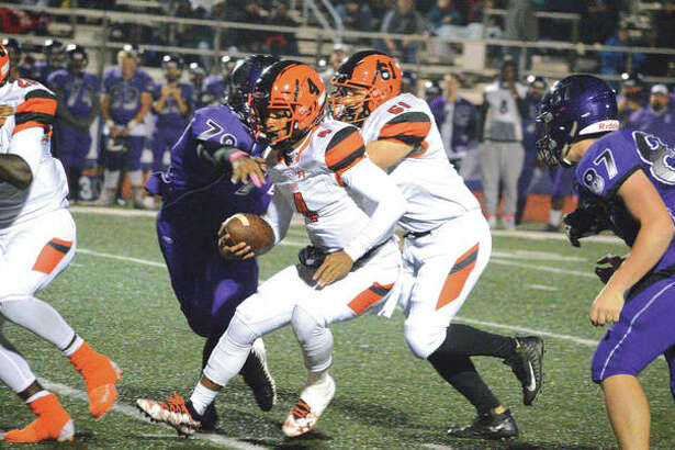 Edwardsville quarterback Kendall Abdur-Rahman runs for a first down during the second quarter of Friday's Southwestern Conference game at Collinsville. It was the final regular-season game for EHS, which will be in the Class 8A playoffs.