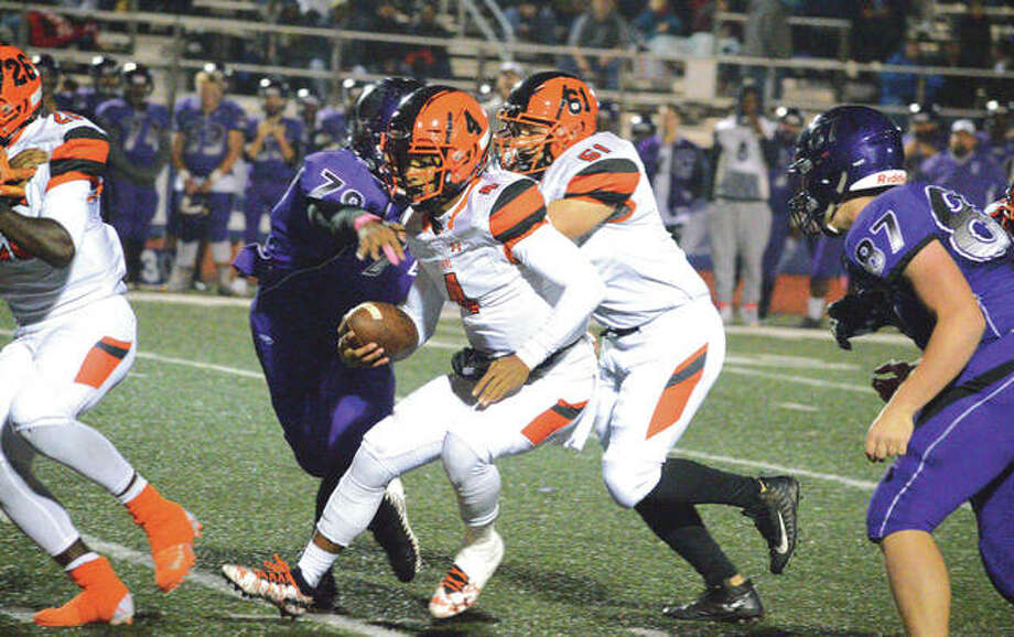 Edwardsville quarterback Kendall Abdur-Rahman runs for a first down during the second quarter of Friday's Southwestern Conference game at Collinsville. It was the final regular-season game for EHS, which will be in the Class 8A playoffs. Photo: Scott Marion/Intelligencer