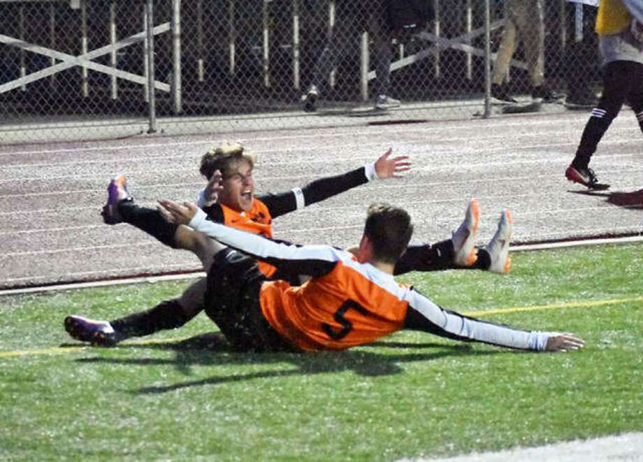 Edwardsville's Josh Reed, back, and Bryce Broshow celebrate after Reed scored the game-winning goal in the 71st minute in the Class 3A O'Fallon Regional championship game Friday in O'Fallon.