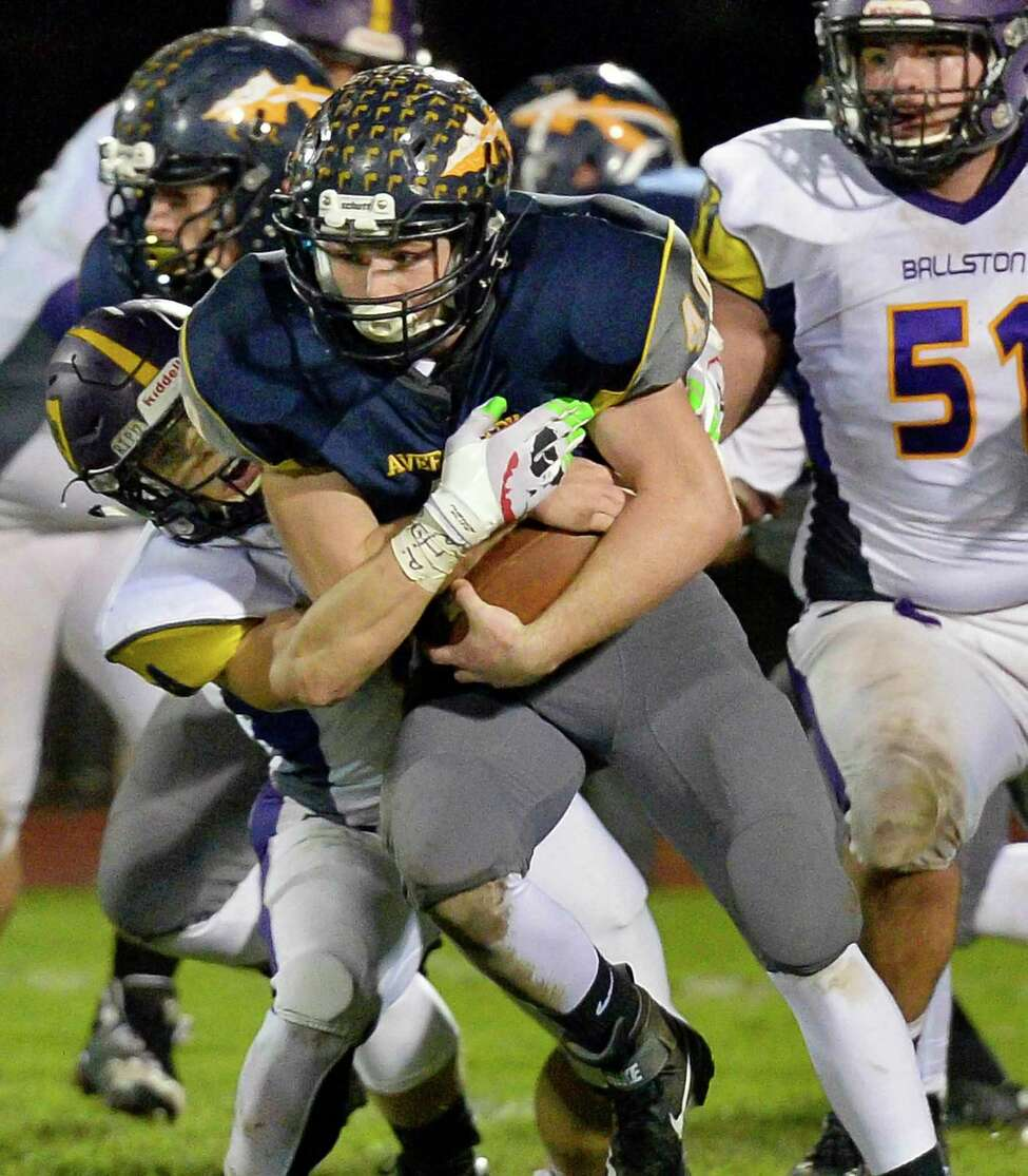 Averill Park's #40 Carl Nitz blasts through Ballston Spa defenders during their Class A quarterfinal Friday Oct. 19, 2018 in Averill Park, NY. (John Carl D'Annibale/Times Union)