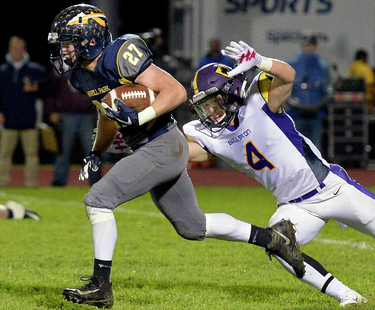 Averill Park's #27 Joseph Milanese tries to keep out of the reach of Ballston Spa's #4 James Prastio Jr. during their Class A quarterfinal Friday Oct. 19, 2018 in Averill Park, NY. (John Carl D'Annibale/Times Union)