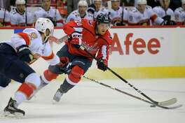 Panthers defenseman Aaron Ekblad, left, looks to prevent Capitals center Lars Eller (20) from advancing during their game Friday night in Washington, D.C. Eller had three assists for the Capitals in a 6-5 loss.