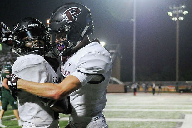 Pearland running back Jaelin Benefield, left, celebrates his touchdown with Andrew Moore during the first half of a high school football game against Strake Jesuit, Friday, Oct. 19, 2018, in Houston. (Eric Christian Smith/Contributor)