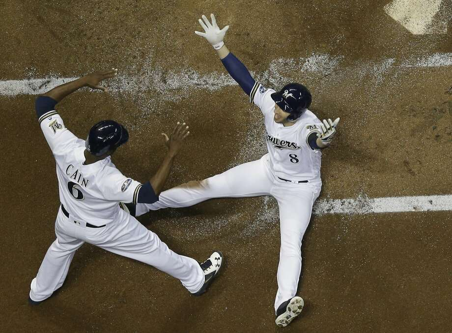 Milwaukee's Ryan Braun celebrates after scoring on a ball hit by Jesus Aguilar in the first inning of Game 6. The Brewers jumped out to a 4-1 lead after one inning. Photo: Morry Gash / Associated Press
