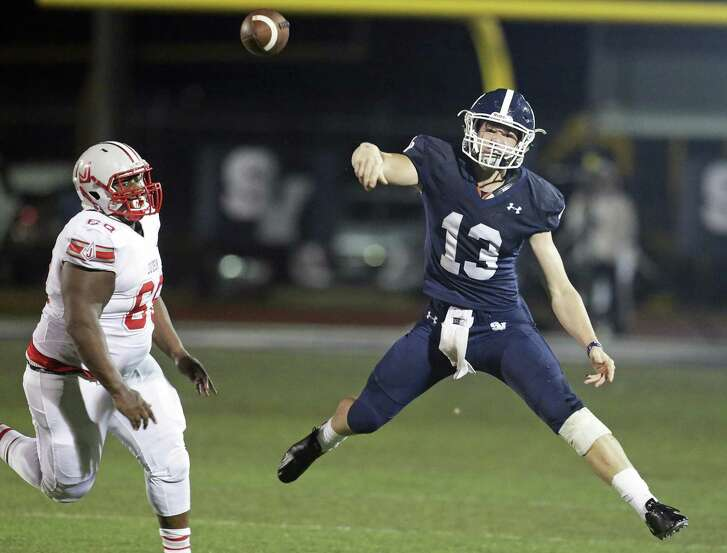Ranger quarterback Levi Williams throws a pass under heavy pursuit by Rocket linemane Daniel Williams as Smithson Valley hosts Judson at Smithson Valley High School on October 19, 2018.