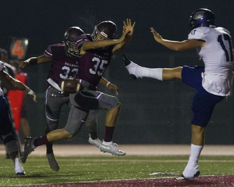 Magnolia linebacker Luke Hearing (35) blocks a punt by College Station kicker Brandon Williams (17) during the first quarter of a District 8-5A high school football game at Bulldog Stadium, Friday, Oct. 19, 2018, in Magnolia. Magnolia defensive back Hunter Kitchens recovered Hearing's block for a touchdown. Photo: Jason Fochtman, Houston Chronicle / Staff Photographer / © 2018 Houston Chronicle
