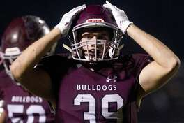 Magnolia linebacker William Spicer (39) reacts as he watches College Station running back Kolbe Cashion run for a 20-yard touchdown to tie the game 35-35 during the fourth quarter of a District 8-5A high school football game at Bulldog Stadium, Friday, Oct. 19, 2018, in Magnolia.