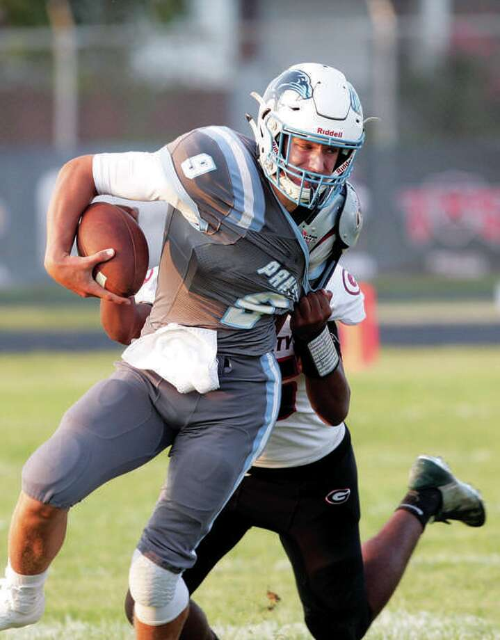 Jersey quarterback Matthew Jackson and his teammates held off Columbia Friday night for a 36-28 road victory that makes the Panthers playoff eligible at 5-4. Photo: James B. Ritter | For The Telegraph