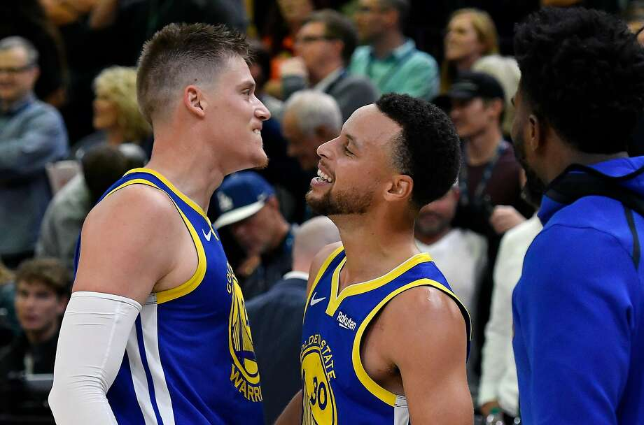 Jonas Jerebko #21 of the Golden State Warriors and teammate Stephen Curry #30 react to their 124-123 win over the Utah Jazz at the end of a NBA game at Vivint Smart Home Arena on October 19, 2018 in Salt Lake City, Utah. Jerebko had the winning basket. Photo: Gene Sweeney Jr., Getty Images
