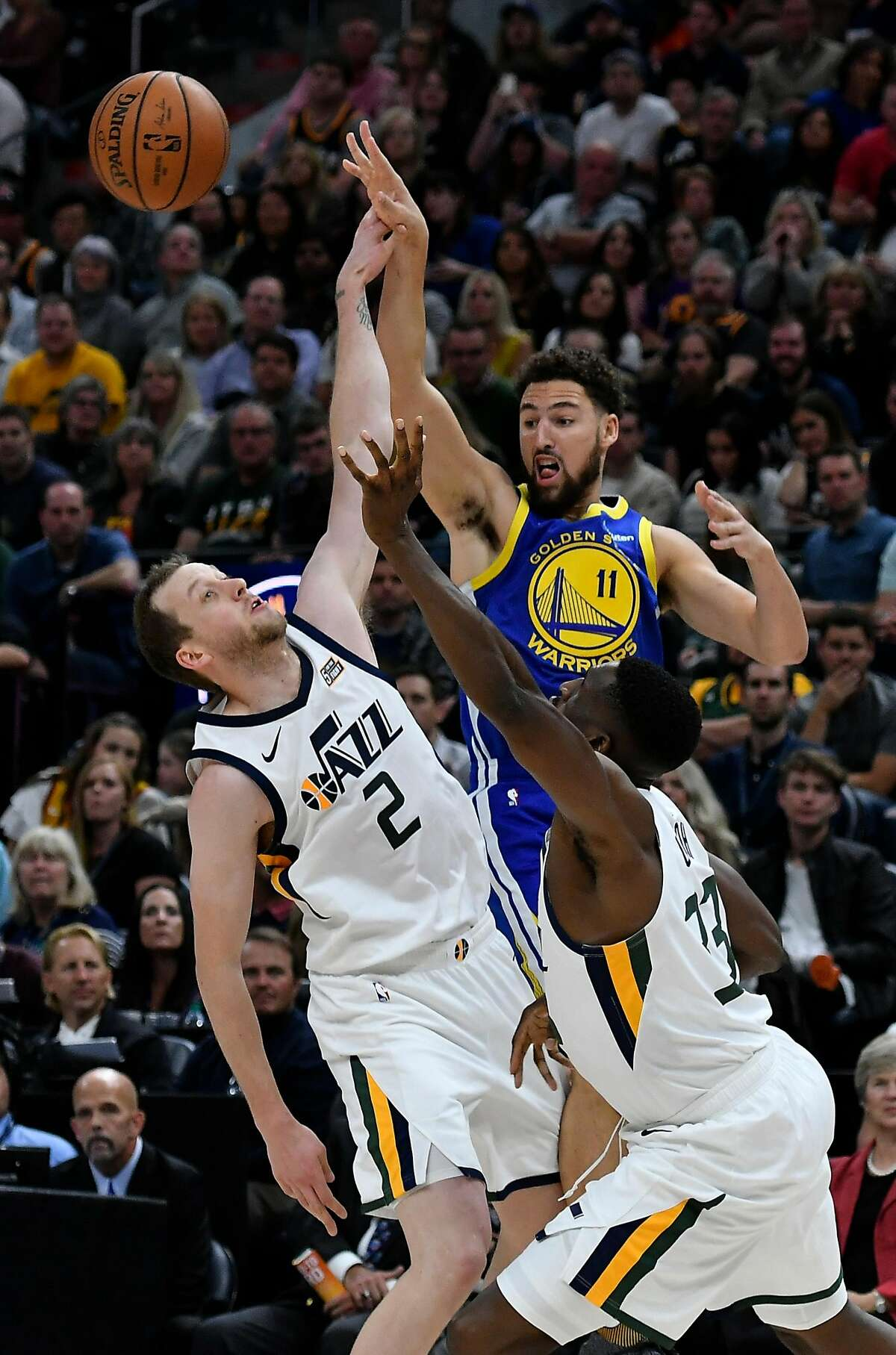 SALT LAKE CITY, UT - OCTOBER 19: Klay Thompson #11 of the Golden State Warriors passes over Joe Ingles #2 of the Utah Jazz and teammate Ekpe Udoh #33 in the first half of a NBA game at Vivint Smart Home Arena on October 19, 2018 in Salt Lake City, Utah. NOTE TO USER: User expressly acknowledges and agrees that, by downloading and or using this photograph, User is consenting to the terms and conditions of the Getty Images License Agreement. (Photo by Gene Sweeney Jr./Getty Images)