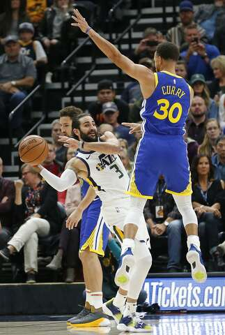 Golden State Warriors guard Stephen Curry (30) guards against Utah Jazz  guard Ricky Rubio e77ba27de