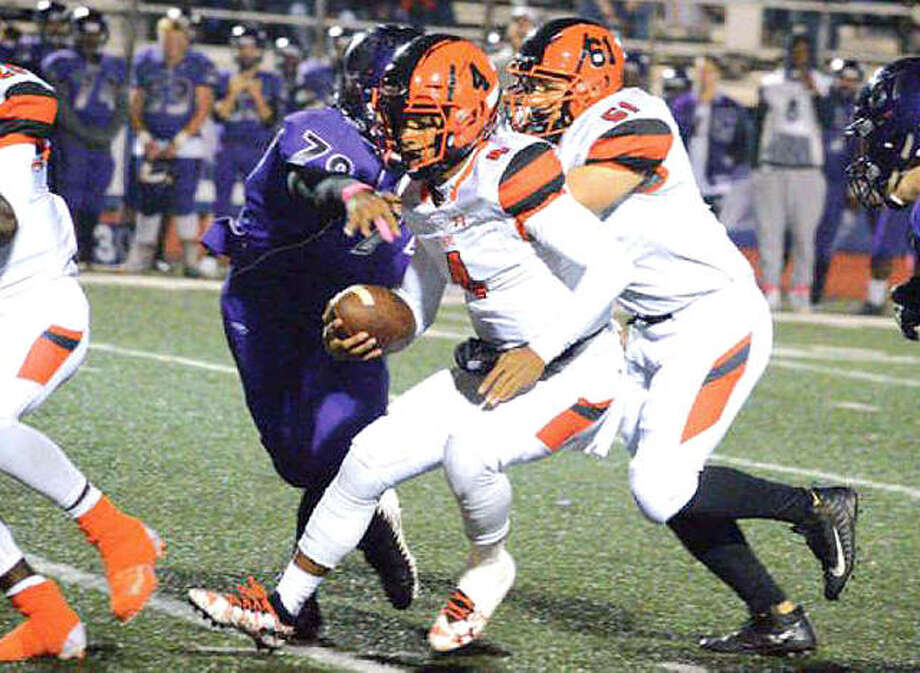 Edwardsville quarterback Kendall Abdur-Rahman runs for a first down during the second quarter of Friday's Southwestern Conference game at Collinsville. The Tigers won 65-13 and will take a 6-3 record to their ninth straight playoff appearance. Photo: Scott Marion | Hearst Illinois