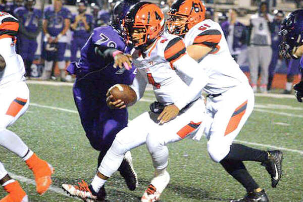 Edwardsville quarterback Kendall Abdur-Rahman runs for a first down during the second quarter of Friday's Southwestern Conference game at Collinsville. The Tigers won 65-13 and will take a 6-3 record to their ninth straight playoff appearance.