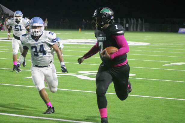Memorial quarterback Sabian Smith sprints for some of his 114 yards during the team's district win over Rayburn, the 14th straight for the Mavs.