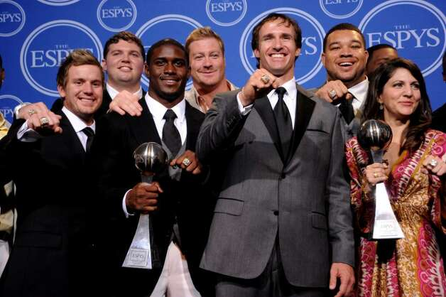 LOS ANGELES, CA - JULY 14:  (2nd L) Reggie Bush, (C) Drew Brees pose along with members of the New Orleans Saints after winning the ESPY for Best Team during the 2010 ESPY Awards at Nokia Theatre L.A. Live on July 14, 2010 in Los Angeles, California.  (Photo by Jason Merritt/Getty Images) *** Local Caption *** Reggie Bush;Sean Payton Photo: Jason Merritt, Getty Images / 2010 Getty Images