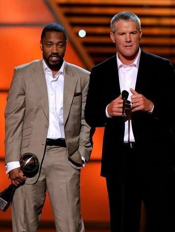 LOS ANGELES, CA - JULY 14:  NFL quarterback Brett Favre and wide receiver Greg Lewis accept the ESPY Award for Best Play during the 2010 ESPY Awards at Nokia Theatre L.A. Live on July 14, 2010 in Los Angeles, California.  (Photo by Kevin Winter/Getty Images) *** Local Caption *** Greg Lewis;Brett Favre Photo: Kevin Winter, Getty Images / 2010 Getty Images