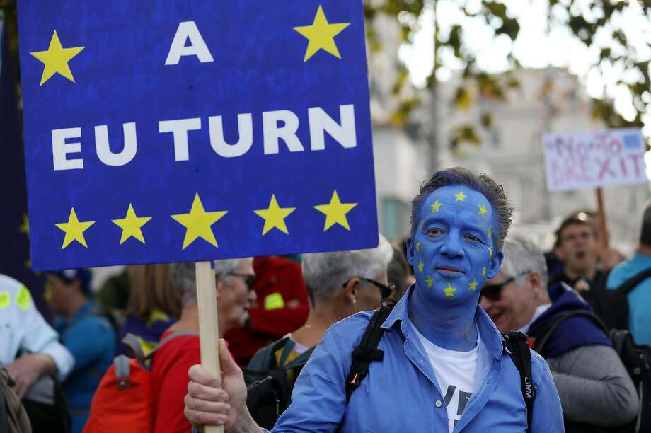 A demonstrator wears face paint in a European Union flag design during a rally in London seeking a new Brexit vote. Photo: Chris Ratcliffe / Bloomberg