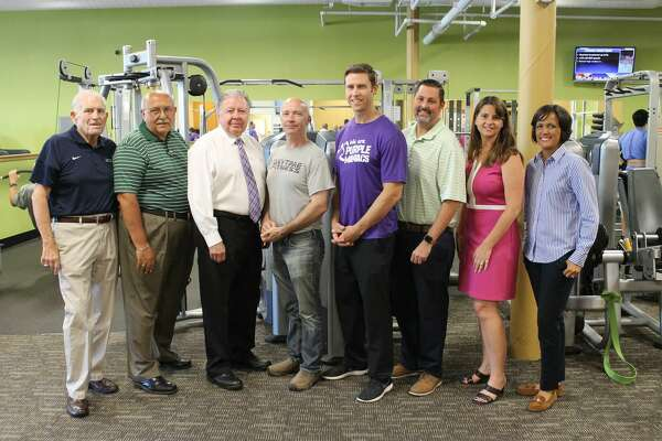 """Anytime Fitness Cromwell celebrated its five-year """"fitversary"""" in late summer. From left are Middlesex County Chamber of Commerce President Larry McHugh, Cromwell Town Manager Tony Salvatore, Chamber Chairman Jay Polke, Anytime Fitness Owners Scott Regina and Andrew Breton, Mayor Enzo Faienza, state Rep. Christie Carpino and Councilwoman Samantha Slade."""