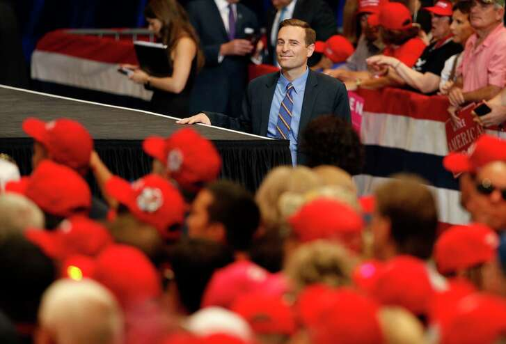 In this Sept. 20, 2018, photo, Nevada state Attorney General Adam Laxalt waits to take the stage before a campaign rally with President Donald Trump in Las Vegas. In the Nevada Governor's race, Laxalt has frequently included anti-California messages in campaign appearances and statements.
