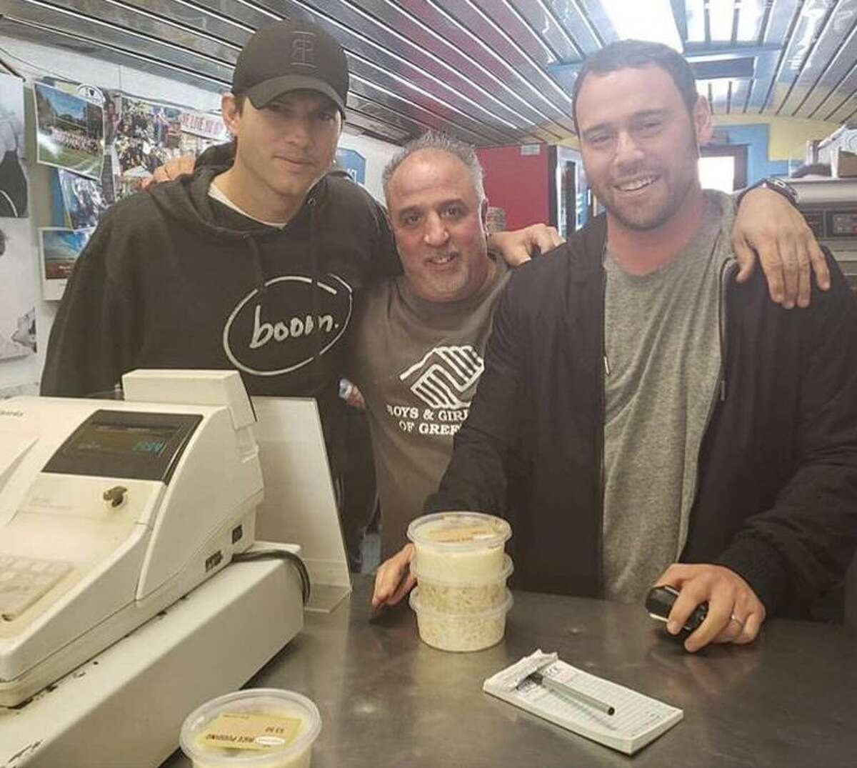 Actor Ashton Kutcher, left, and Cos Cob native and talent manager to the stars Scooter Braun, right, with Garden Catering manager Michael Paoletta at Garden Catering in Old Greenwich on Thursday afternoon.