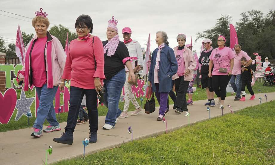 Cancer survivors, care givers and family members walk around Grafa Park 10/20/18 for Pink the Park. Tim Fischer/Reporter-Telegram Photo: Tim Fischer/Midland Reporter-Telegram