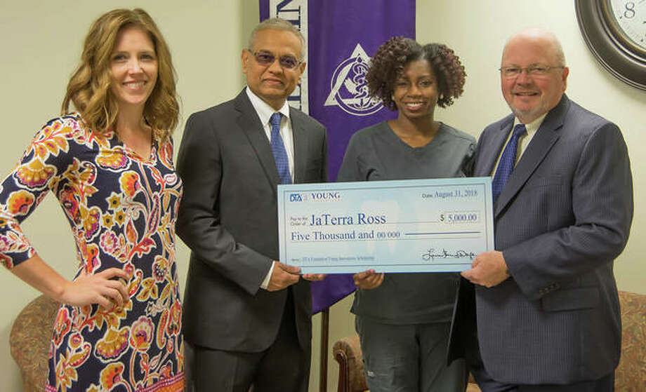 From left, SIU SDM Director of Community Dentistry Dr. Katie Kosten; Director of Operations with Young Dental Rajul Amin, representing the Dental Trades Alliance Foundation; scholarship recipient Jaterra Castine-Ross; and SIU SDM Dean Dr. Bruce Rotter. Photo: For The Telegraph