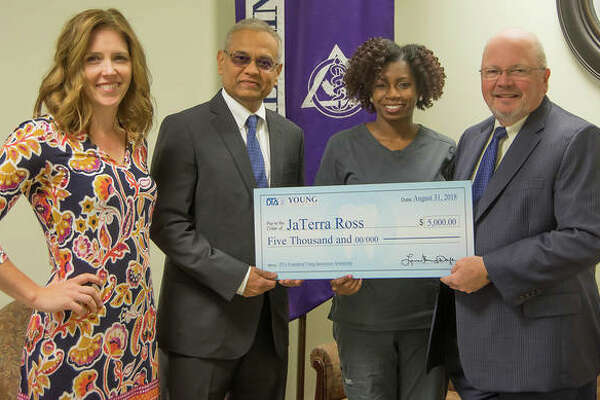From left, SIU SDM Director of Community Dentistry Dr. Katie Kosten; Director of Operations with Young Dental Rajul Amin, representing the Dental Trades Alliance Foundation; scholarship recipient Jaterra Castine-Ross; and SIU SDM Dean Dr. Bruce Rotter.