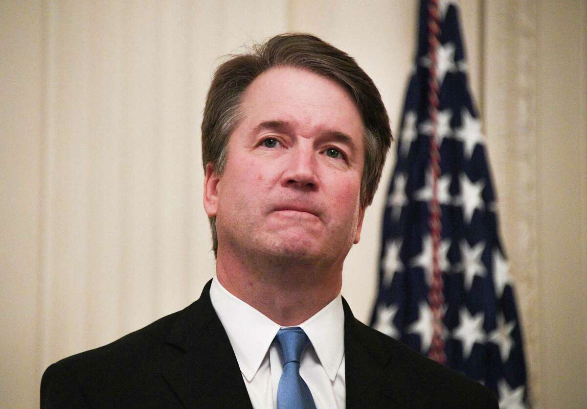 (FILES) In this file photo taken on October 8, 2018 Brett Kavanaugh waits before being sworn-in as Associate Justice of the US Supreme Court in the East room of the White House in Washington, DC. - The US Supreme Court is supposed to be a sacred institution impervious to partisan politics but the newly confirmed justice Brett Kavanaugh gives the court its staunchest conservative majority in decades. As he was sworn in Monday night at the White House, after an ugly, contentious Senate confirmation process in which he battled allegations of sexually assaulting women, Kavanaugh, 53, vowed to serve the country -- not one political party or another.
