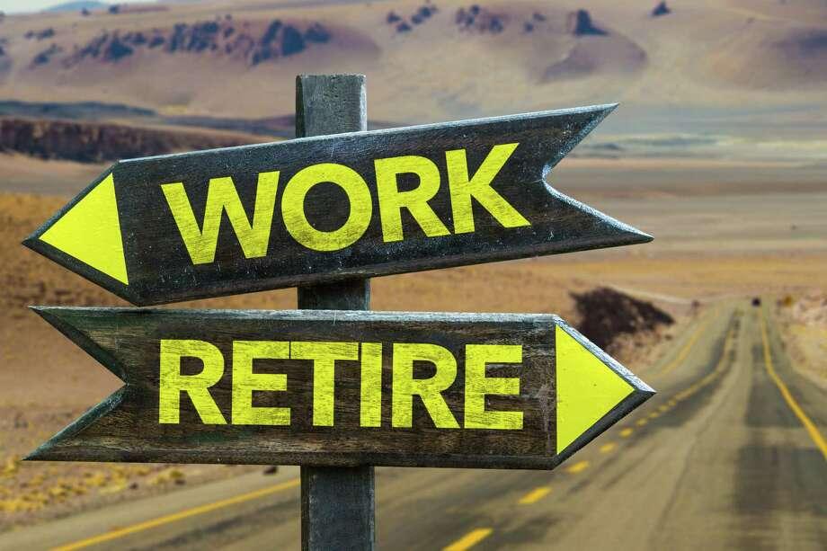 Work vs Retire crossroad Photo: Gustavofrazao / iStockphoto