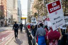 San Francisco police officers follow the crowd as hotel and hospitality workers on strike from seven different Marriott-affiliated hotels march through the streets of San Francisco, Calif. Saturday, Oct. 20, 2018.
