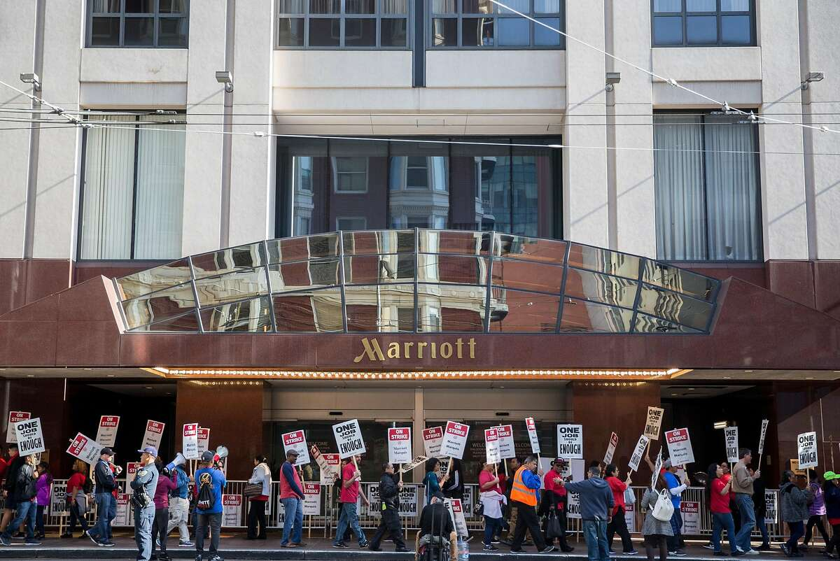 Marriott-affiliated hotel and hospitality workers on strike picket outside the Marriott Marquis hotel Saturday, Oct. 20, 2018 in San Francisco, Calif.