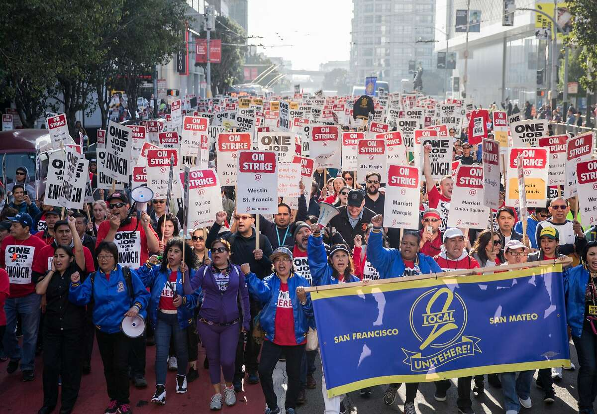 More than one thousand hotel and hospitality workers on strike from seven different Marriott-affiliated hotels march through the streets of San Francisco, Calif. Saturday, Oct. 20, 2018.