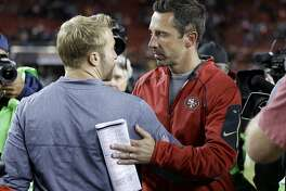 FILE - In this Sept. 21, 2017 file photo Los Angeles Rams coach Sean McVay, left, greets San Francisco 49ers coach Kyle Shanahan after an NFL football game in Santa Clara, Calif. McVay and Shanahan arrived as head coaches in the NFC West together last year as longtime friends and colleagues tasked with revitalizing struggling franchises. McVay has done a much quicker job overhauling the Rams than Shanahan has with the 49ers. The teams headed in opposite directions meet for the first time this season on Sunday, Oct. 21, 2018 when the Rams (6-0) hope to remain the NFL's only unbeaten team when they visit the struggling 49ers (1-5). (AP Photo/Ben Margot, file)