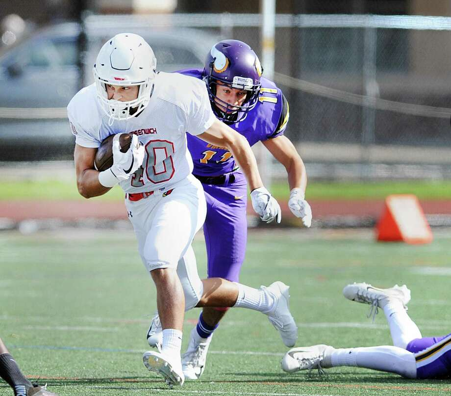 Greenwich running back Tysen Comizio (#40) beats Westhill defenderJohn Mendez (#11) for a big gain on a first quarter run during the high school football game between Westhill High School and Greenwich High School at Westhill in Stamford, Conn., Saturday, Oct. 20, 2018. Photo: Bob Luckey Jr. / Hearst Connecticut Media / Greenwich Time