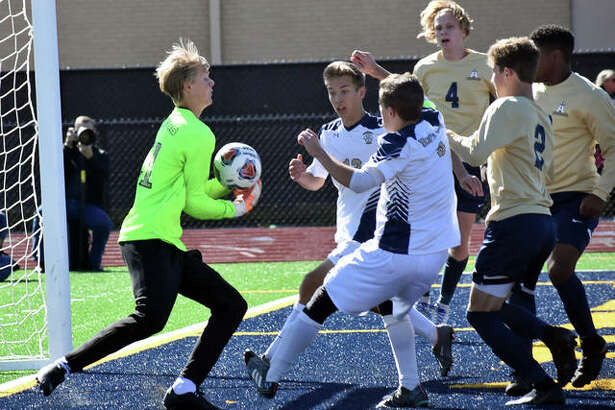 FMCHS keeper Nate Dammerich makes a save late in the first half against Belleville Althoff on Saturday.