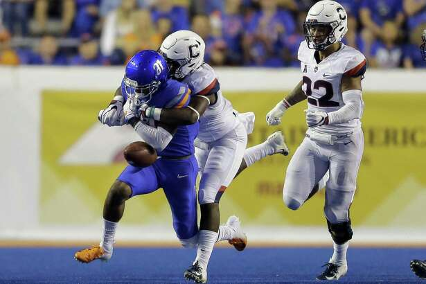 UConn defensive back Messiah Turner knocks the ball out of the hands of Boise State wide receiver Akilian Butler during a game earlier this season.