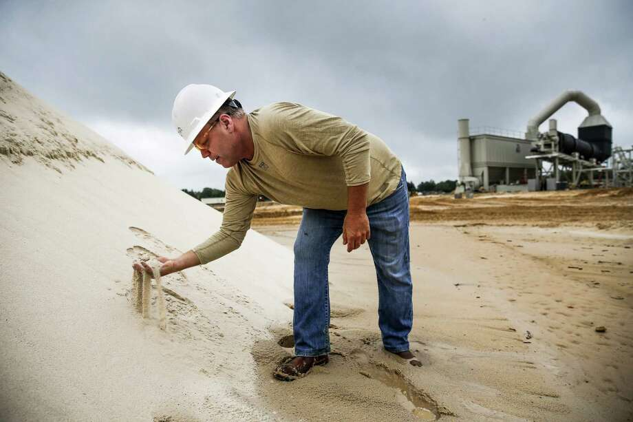 WildHorse Resource Development environment, health and safety vice president Todd Mucha grabs a handful of sand collected from the new WIldHorse sand mine for use in fracking operations Tuesday Oct. 2, 2018 in Caldwell. Photo: Michael Ciaglo, Houston Chronicle / Staff Photographer / Michael Ciaglo