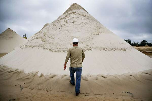 WildHorse Resource Development environment, health and safety vice president Todd Mucha walks up to a pile of sand collected from the new WIldHorse sand mine for use in fracking operations Tuesday Oct. 2, 2018 in Caldwell.