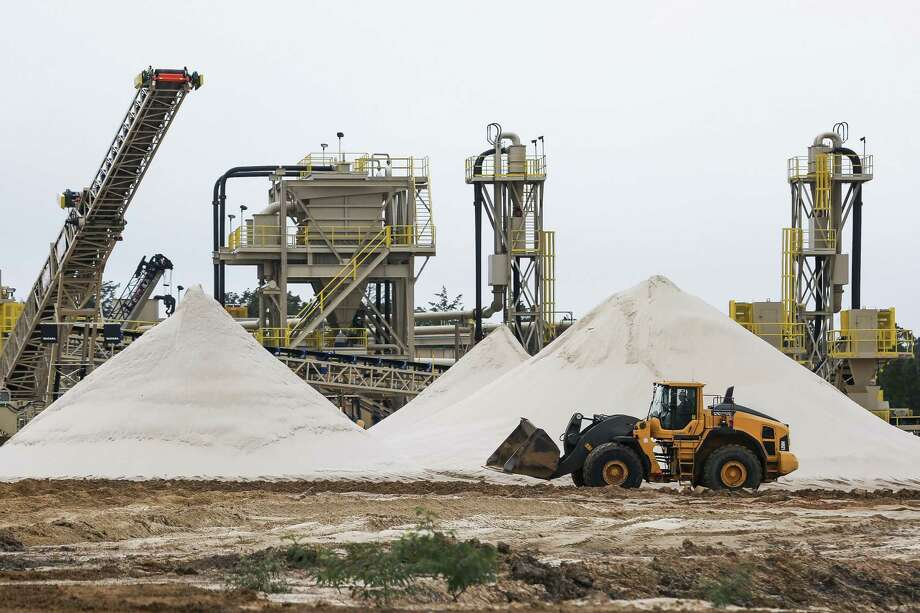 A WildHorse Resource Development front end loader drives past piles of sand for use in fracking operations at the new sand mine Tuesday Oct. 2, 2018 in Caldwell. Continue to get a look inside a frac sand mine operation.  Photo: Michael Ciaglo, Houston Chronicle / Staff Photographer / Michael Ciaglo