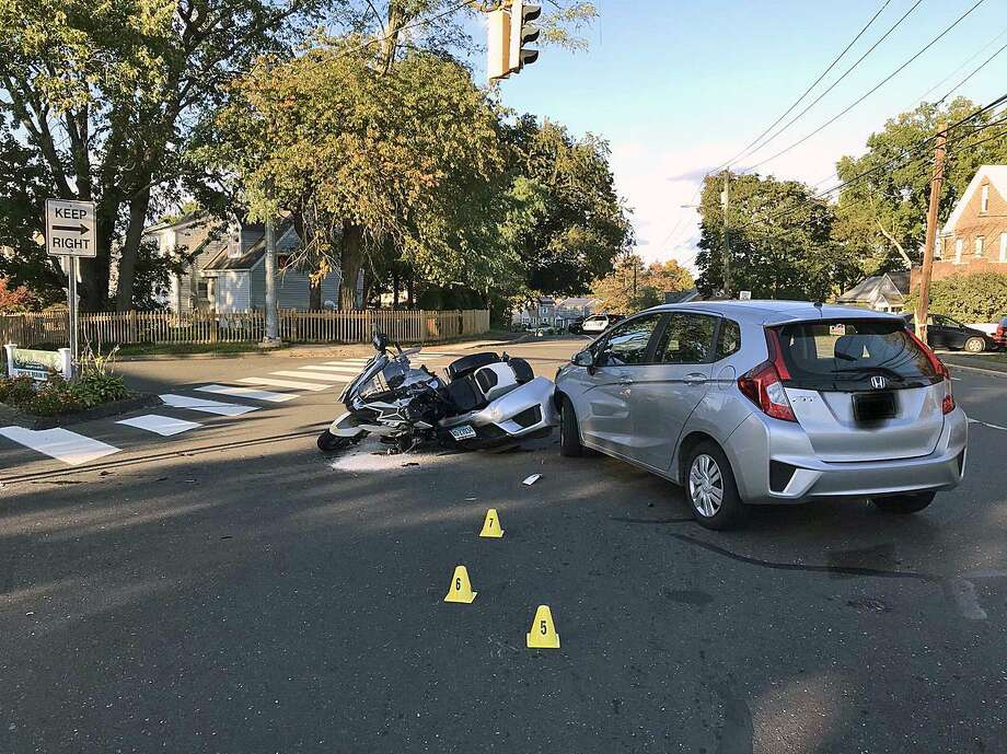 A crash in Norwalk, Conn., on Oct. 20, 2018, involving a Norwalk police officer. The blurring out of the car's licence plate was done by police, not Hearst Connecticut Media. Photo: Contributed Photo / Norwalk Police Department / Contributed Photo / Connecticut Post Contributed