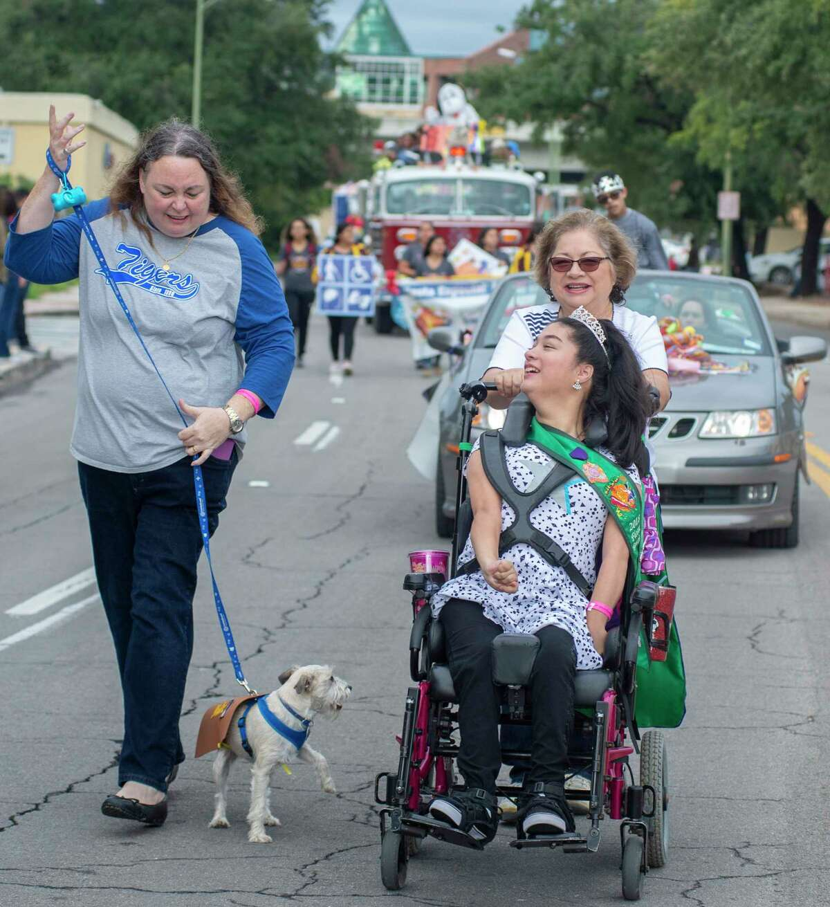 2018 Fiesta Especial Queen Vanesa Serana, 21, and Gypsy the dog participate in the inaugural abilitySTRONG Parade on Saturday, October 20, 2018.