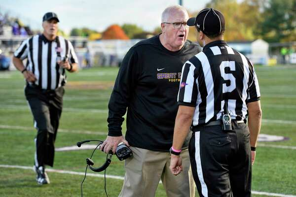 UAlbany head coach Greg Gattuso discusses one of several disputed calls with officials during Saturday's Colonial Athletic Association game against Towson Oct. 20, 2018 in Albany, NY. (John Carl D'Annibale/Times Union)