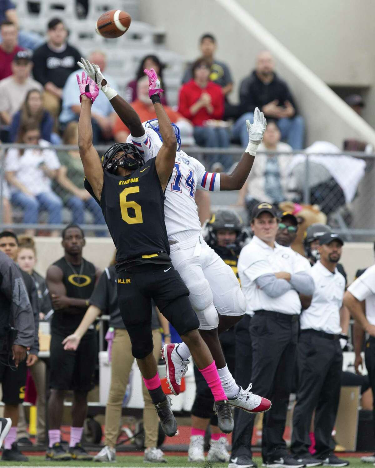 Klein Oak strong safety Christopher Satterfield (6) breaks up a pass intended for Oak Ridge wide receiver Rowry Bailey (14) during the second quarter of a District 15-6A high school football game at Klein Memorial Stadium, Saturday, Oct. 20, 2018, in Spring.