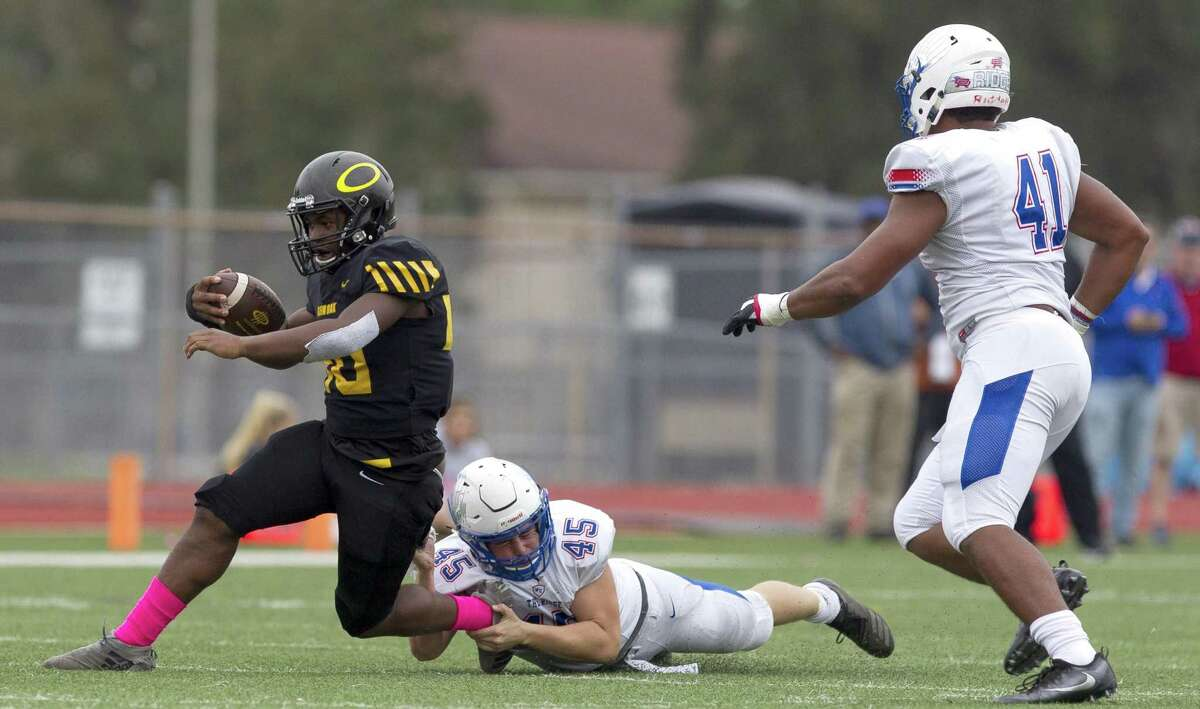 Oak Ridge linebacker Chris Young (45) brings down Klein Oak running back Drew Lewis (20) during the third quarter of a District 15-6A high school football game at Klein Memorial Stadium, Saturday, Oct. 20, 2018, in Spring.