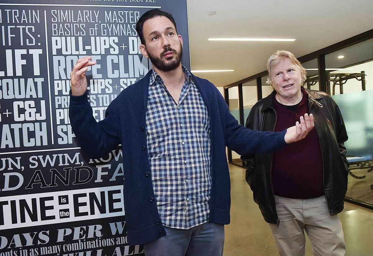 David Salinas, CEO and co-founder of District New Haven at 470 James St., talks about the facility with Michael Mercier, an aldermanic aid, on Thursday.