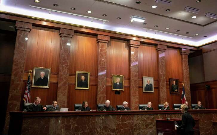 Texas Supreme Court justices hear arguments in a case last month.