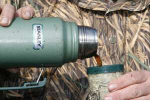 """Since 1913, millions of Texas' hunters have been made warmer sipping cups of coffee poured from the nearly indestructible """"classic"""" Stanley stainless steel vacuum bottle. And, in a pinch, the double-walled bottle makes a passable hammer."""