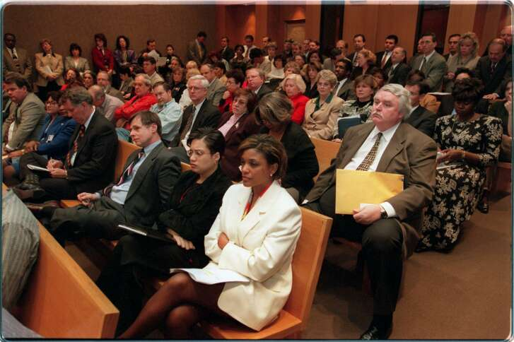 In this photo from 1998, a hostile crowd stewed as members of Harris County Commissioners Court debated, then passed, a plan to increase their own and other top county officials' pay by 24 percent to $115,995 annually.