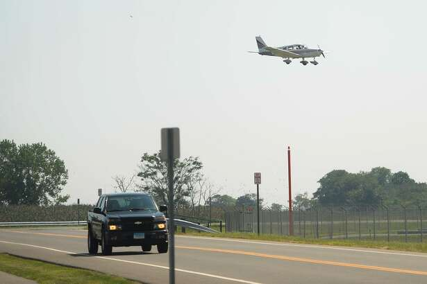 FILE PHOTO - Taken from Main Street as a plane makes its way to land at Sikorsky Airport on Aug. 29, 2018. The plane photographed here does not necessarily depict a similar plane to the one that made an emergency lading at the Sikorsky Airport in Stratford, Conn., on Oct. 20, 2018.