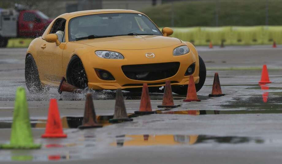 Teenage drivers skidded across pads during the Tire Rack Street Survival® Teen Driving School at Houston Police Academy on Saturday. Coordinators put dish soap on the skid pad exercise track for students to learn how to control a skidding car and how to avoid accidents. Photo: Yi-Chin Lee, Houston Chronicle / Staff Photographer / © 2018 Houston Chronicle